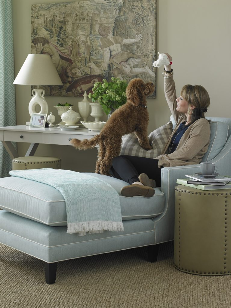 Photograph Courtesy of The MT Company. The fabric and furniture seen here is available at Saratoga Signature Interiors. Sunbrella fabric allows you the freedom to choose lighter colors! Go ahead and let your pooch play!