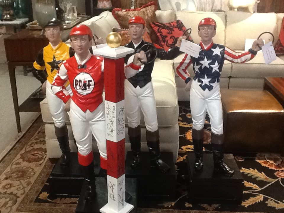 A lawn jockey statue hand painted by Saratoga Signature Interiors