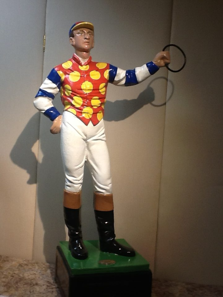A lawn jockey hand painted by Saratoga Signature